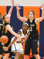 Beech High senior guard Deja Smith passes to a teammate