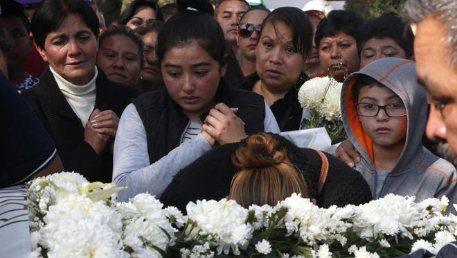 Relatives cry during a funeral of a person who died when a gas pipeline exploded in the village of Tlahuelilpan, Mexico,Jan. 20, 2019. A massive fireball that engulfed locals scooping up fuel spilling from a pipeline ruptured by thieves in central Mexico killed dozens of people and badly burned dozens more on Jan. 18.