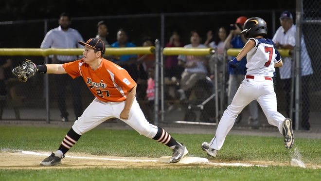 Beverly's Nick Fox is shown making an out at first base on Swampscott's Pierce Friedman during a Little League game at Harry Ball Field in 2016. Three years later, Fox is getting ready to play in the new Essex County Baseball League on the 17U Beverly/Salem team.