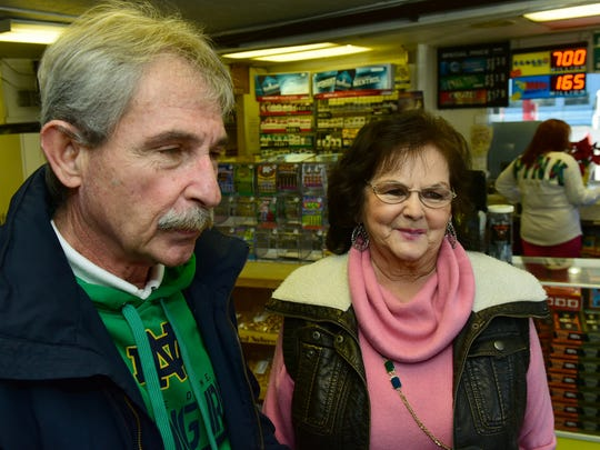 Francis Cameron and Susan Pifer talk to reporters about what they would do if they won the Powerball jackpot. By Thursday afternoon, Jan. 7, 2016 at Bill's Kwik Chek, Chambersburg. The jackpot was listed as $700 million. Cameron said he would  fly to Scotland to play around a golf at the best clubs.