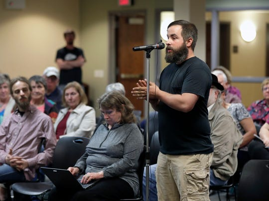 David Williams of Neenah poses a question during a