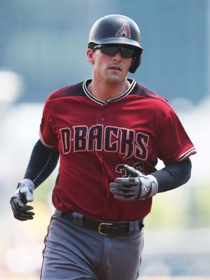 Jun 24, 2018: Arizona Diamondbacks catcher John Ryan Murphy (36) circles the bases on a solo home run against the Pittsburgh Pirates during the second inning at PNC Park.