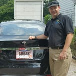 Joshua Brown stands by his new Tesla electric car.