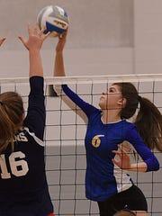 Junior captain Lauren Wenzel led Marian with 15 kills