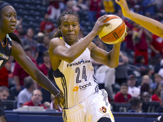 Indiana Fever forward Tamika Catchings (24) drives the ball into the lane during the first half of a WNBA Eastern Conference Finals game, Sunday, September 27, 2015, at Bankers Life Fieldhouse in Indianapolis.