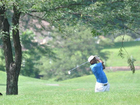 A golfer makes a shot during a York County Amateur