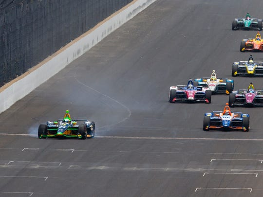 Dreyer & Reinbold Racing IndyCar driver Sage Karam (24) heads toward the wall of the front straightaway as he crosses the yard of bricks during the race at Indianapolis Motor Speedway on Sunday, May 27, 2018.
