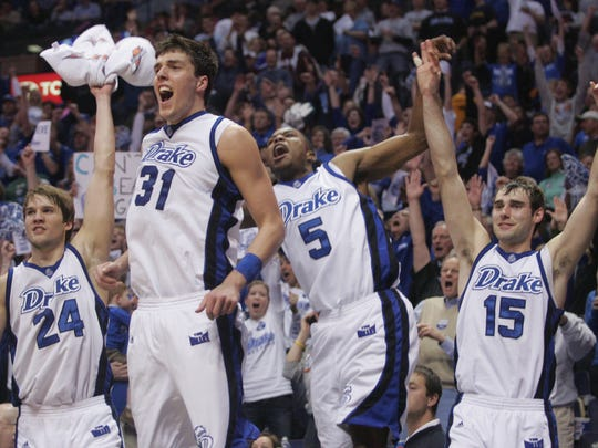 From left, Drake starters Klayton Korver, Jonathan Cox, Leonard Houston and Adam Emmenecker rejoice in the closing seconds of their 79-49 win over Illinois State in the championship of the Missouri Valley Conference Tournament on March 9, 2008 in St. Louis.