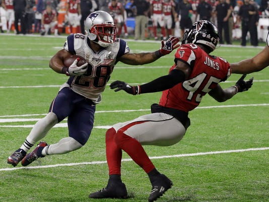 New England Patriots' James White runs for a touchdown as Atlanta Falcons' Deion Jones attempts to defend during overtime of the NFL Super Bowl 51 football game against the Atlanta Falcons, Sunday, Feb. 5, 2017, in Houston. The Patriots defeated the Falcons 34-28. (AP Photo/Patrick Semansky)
