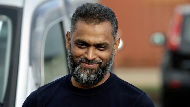 British Moazzam Begg leaves Belmarsh Prison in south London, after his release on Oct. 1, 2014. British prosecutors dropped terrorism charges against the former Guantanamo Bay detainee who is a high-profile advocate for the rights of terror suspects.