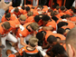 Members of the Central York football team pray with