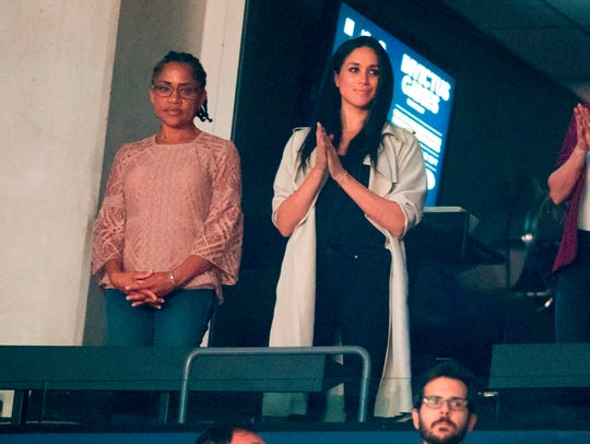 Meghan Markle (C) and her mother Doria Ragland (L)