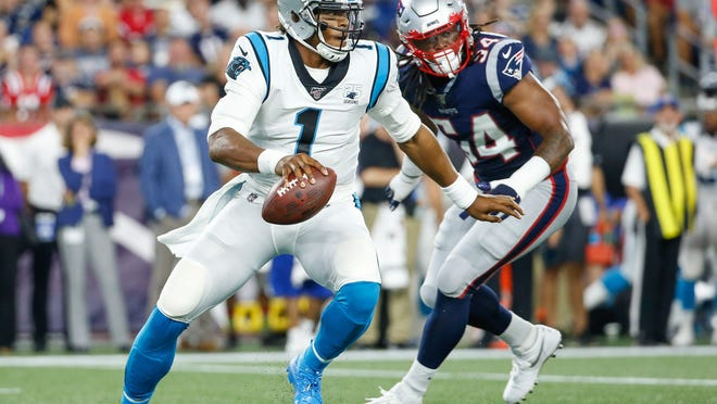 Carolina Panthers quarterback Cam Newton (1) is forced out of the pocket by New England Patriots outside linebacker Dont'a Hightower (54) during the first half at Gillette Stadium on Aug. 22, 2019.