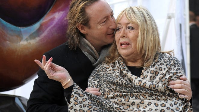 Cynthia Lennon and her son Julian at the unveiling of a peace monument dedicated to the memory of her former husband John Lennon in Liverpool.