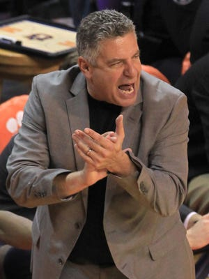 Auburn head coach Bruce Pearl yells at his team in the second half of their NCAA college basketball game against Clemson on Sunday.