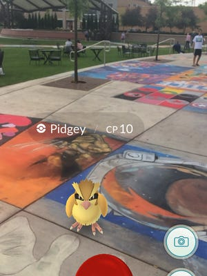 The new Pokemon Go app, which came out last week, requires users to walk around their neighborhood to catch the little creatures, like Pidgey in The 400 Block.