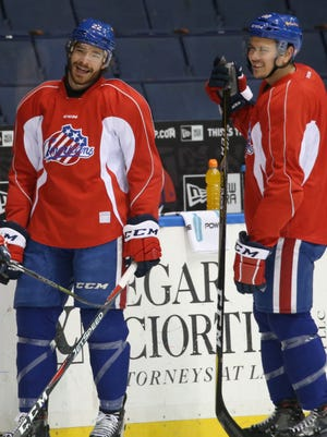 Rochester American's defenseman Zach Redmond, left, shares a laugh with teammate Stuart Percy, right, during the team's practice Tuesday, April 17, 2018 at the Blue Cross Arena at the War Memorial in Rochester.