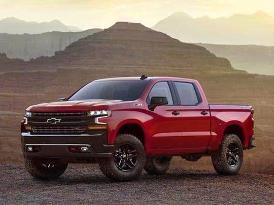 A red 2019 Chevrolet Silverado pickup truck in a desert setting.