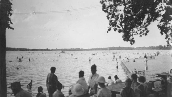 In this 1930s postcard view, people gather at Hayes State Park along the shores of Wamplers Lake to enjoy a swim or the lake breeze.