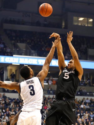 Dec 31, 2014; Cincinnati, OH, USA; Georgetown Hoyas forward Mikael Hopkins (3) defends against Xavier Musketeers forward Trevon Bluiett (5) during the first half at Cintas Center. Mandatory Credit: Aaron Doster-USA TODAY Sports