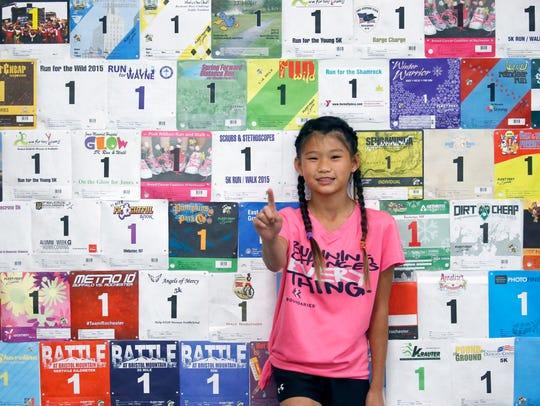 Ten-year-old Ari Reback of Fairport, a runner who is