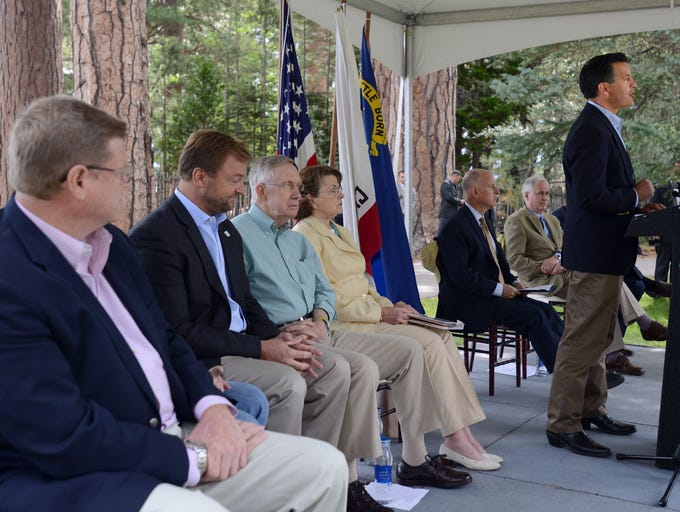 Nev. Gov. Brian Sandoval addresses the Tahoe Summit at the Tallac Historical site Tuesday A?ug. 19, 2014. Seated behind him from left are Nev. Congressman Mark Amodei,C?alif., Congressman John Garamendi. Nev. U.S. Sen. Dean Heller, Nev. U.S. Sen. Harry Reid Calif. U.S. Sen. Diane Feinstein. Nev. Gov. Brian Sandoval, Calif. Congressman Tom McClintock and Calif. Lt. Gov. Gavin Newsom.