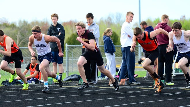 Sam Larson (center) of Luxemburg-Casco gets a great start coming off the blocks in his heat of 110 high hurdles during Tuesday's triangular meet.