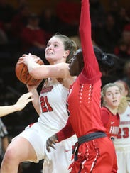 Marist's Willow Duffell goes for a layup alongside Fairfield's Khadidiatou Diouf on Jan. 13.