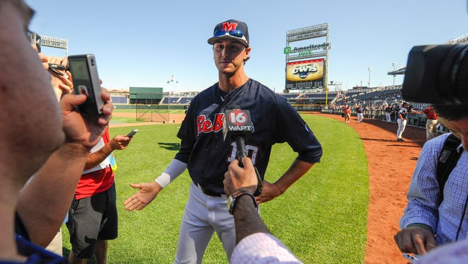 Ole Miss pitcher Chris Ellis (10) speaks to reporters following team practice on Friday, June 13, 2014, ahead of the NCAA baseball College World Series tournament at TD Ameritrade Park in Omaha, Neb. Mississippi plays Virginia on Sunday. (AP Photo/Dave Weaver)