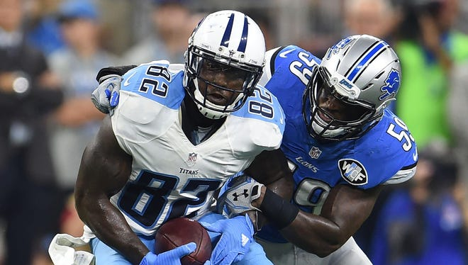 Lions linebacker Tahir Whitehead tries to corral Titans tight end Delanie Walker at Ford Field in Week 2 of the 2016 season.