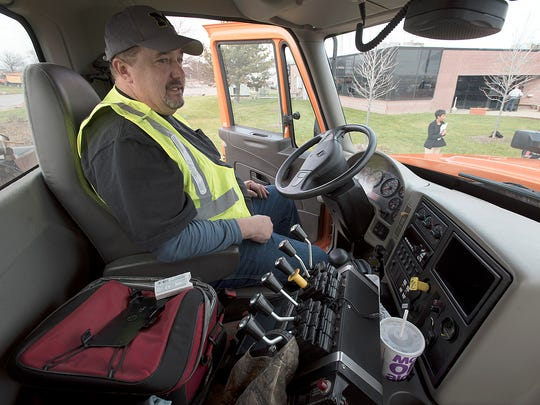 Todd Strachan spends hours in this truck, keeping the roads clear when bad winter weather hits.
