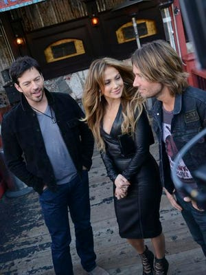 'American Idol' judges Harry Connick Jr., left, Jennifer Lopez and Keith Urban attend the show's  Season 14 Showcase on Dec. 6 at the House of Blues in Hollywood, Calif.