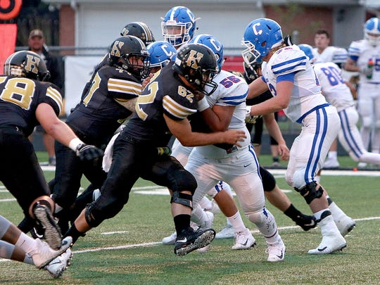 Henrietta defensive linemen Ross Cantwell (77) and