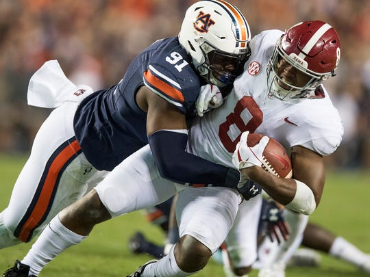 Alabama running back Josh Jacobs (8) is stopped by
