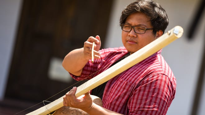 Reporter Kevin Tano learned how to build a belembaotuyan, a traditional Chamoru single-string instrument, at the Lujan House in Hagåtña.