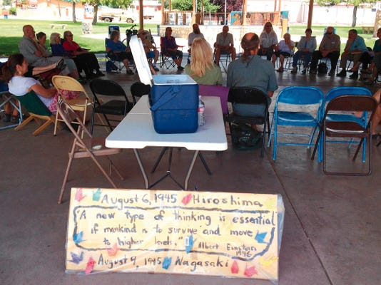 Gila Friends Meeting (Quakers) held a Hiroshima & Nagasaki Commemoration service on Sunday in Gough Park. It is the 70th anniversary of the dropping of the atomic bombs on Japan. The bombing of Hiroshima occurred on Aug. 6, 1945, and Nagasaki was bombed on Aug. 9. Randal Seyler   Sun-News