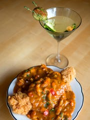 Catfish Louisianne with a cucumber cosmo cocktail at Mo' Betta Gumbo in Loveland Monday, August 25, 2014.