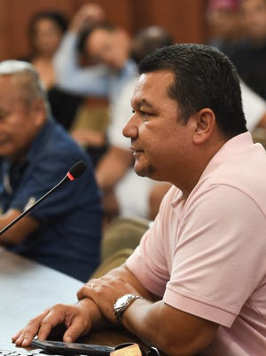 Eric Palacios speaks on behalf of Gov. Eddie Calvo during a public hearing on the recreational marijuana bill at the Guam Congress Building in Hagåtña on April 11, 2017. Palacios told lawmakers that Calvo is suspending his push for further action on the measure he authored earlier this year.