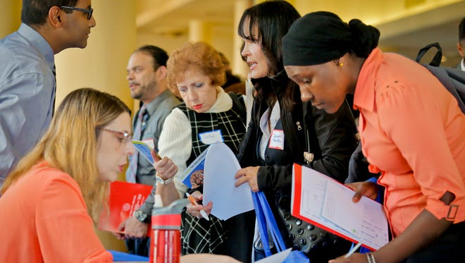 Job seekers attend the New York Department of Citywide Administrative Services (DCAS) 2016 job fair.
