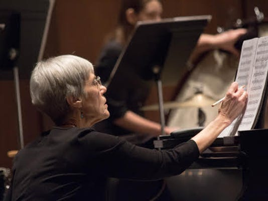 Carolyn Bridger at piano art.jpg