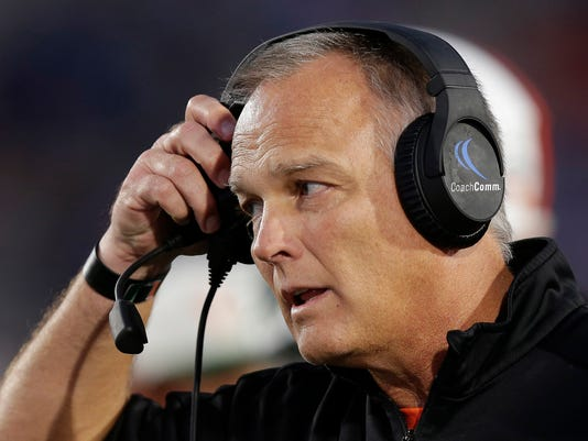 Miami Hurricanes head coach Mark Richt listens to an official during the first half of an NCAA college football game against Duke in Durham, N.C., Friday, Sept. 29, 2017. (AP Photo/Gerry Broome)