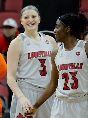 Louisville's Sam Fuehring (#3) and Jazmine Jones celebrate.
