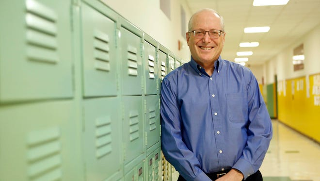 Bud Kroll, a Yonkers Partners in Education board member, is seen here at Palisade Preparatory School in Yonkers. He recently released a study that found a strong link between community poverty and student achievement.