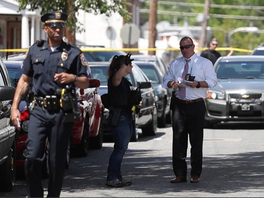 Wilmington police investigate the scene of a shooting in the 200 block of S. Harrison St. on Thursday afternoon.