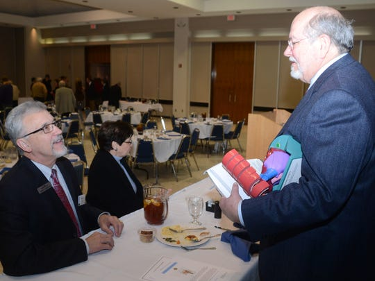 Kermit Pharris (left) speaks with cardiologist Dr. Robert Freedman who was the guest speaker at the Rotary Club of Alexandria Tuesday, Feb. 17, 2015.