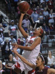 Hermleigh's Brishaya Sneed, left, sails to the basket
