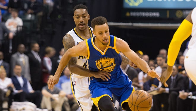Golden State Warriors guard Stephen Curry (30) is fouled by Indiana Pacers guard Jeff Teague (44) in the first half of the game at Bankers Life Fieldhouse.