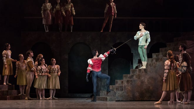 """Tybalt (Edward Gonzalez Kay, with the sword) challenges an unwilling Romeo (Cervilio Miguel Amador) to a duel in one of the opening scenes of Cincinnati Ballet's presentation of """"Romeo and Juliet."""" Choreographed by artistic director Victoria Morgan, the production runs through October 29 at Music Hall. Photo: Peter Mueller."""