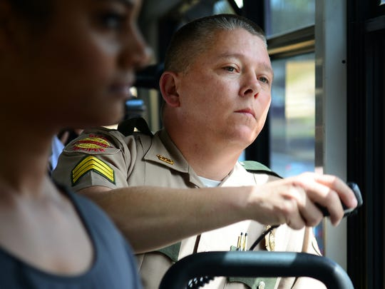 Tennessee Highway Patrol Sgt. Jeromy Edwards looks out the window of a Tennessee Highway Patrol bus to spot motorist engaged in distracted driving, Monday, April 10, during Tennessee's first statewide distracted driving enforcement bus tour.