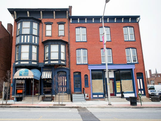 The original York Blue Moon at left and the bar renovation at right are in the 300 block of West Market Street in York. The bar, a project four years in the making, opened earlier this year.But it is now closed.